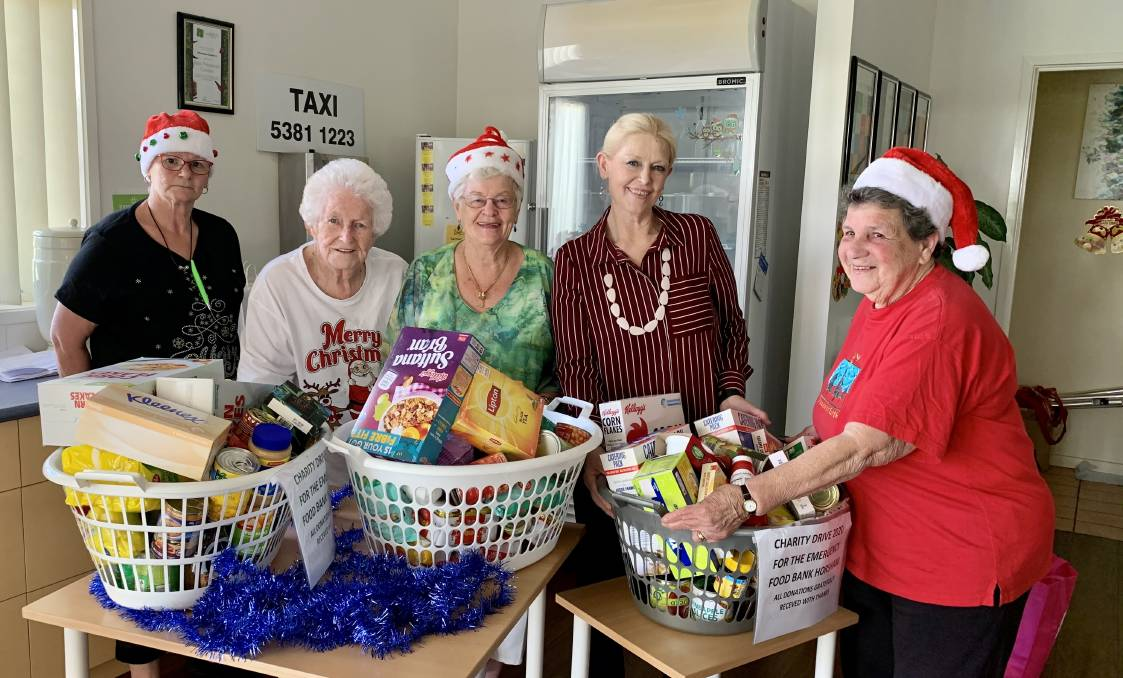 That's the spirit: Barb Cavanagh, Shirley Brajonje, Fay Nusky, Bev Miatke and Iris Williams as the Ingenia Gardens Christmas lunch and handover of the great amount of goodies collected by the residents. Picture: ALISON FOLETTA.