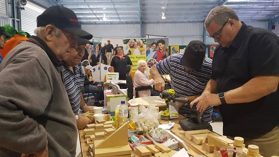 MENS SHED: Before COVID lockdown Horsham Men's Shed organised field days, where members would showcase some of their handiwork skills. Picture: HORSHAM MEN