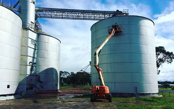 START OF THE PROCESS: Geoffrey Carran begins work on painting the GrainCorp silos at Goroke. Picture: @geoffreycarran