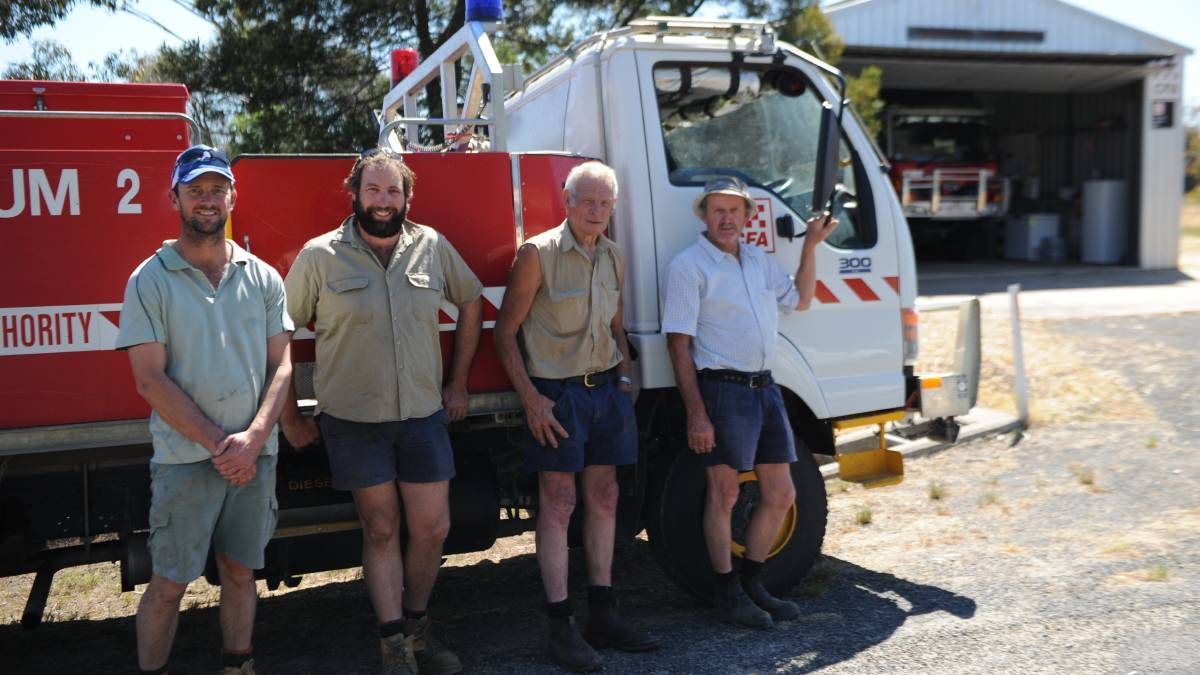 GRASS FIRE WARNING: Laharum Captain Luke Dumesny, left, with other members of the Grampians Group CFA in 2019.