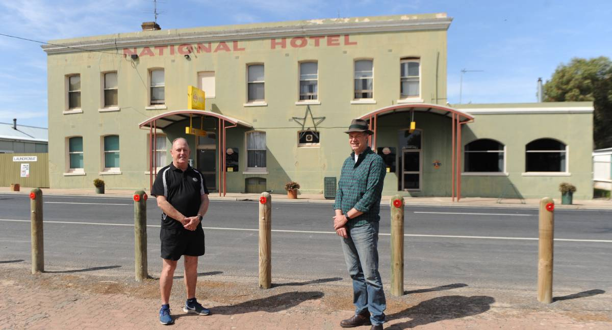 NATI's NAT: National Hotel Licensee Bill Lovel with Dr Rob Grenfell, who is asking each resident to buy one takeaway meal from the venue a week. Picture: ALEXANDER DARLING