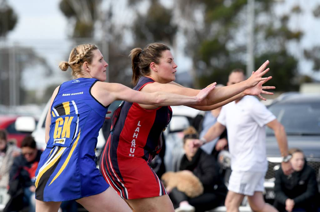GAME ON: Natimuk United's Casey Vanstan and Laharum's Caitlin Story battle it out. Picture: SAMANTHA CAMARRI