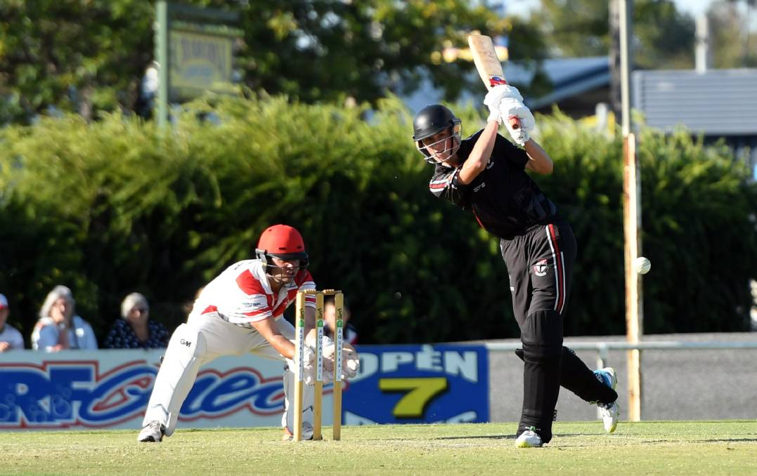 IN THE RUNS: Horsham Saints' Corey Smith drives against Homers in last season's one-day grand final.