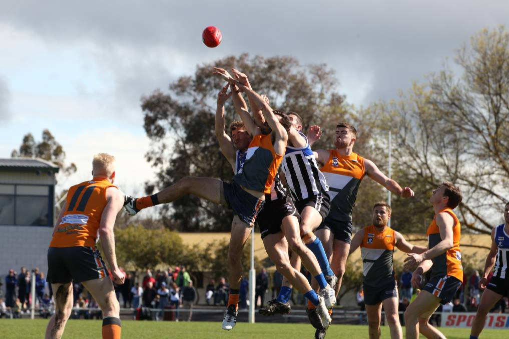 Southern Mallee's Sam Weddell and Minyip-Murtoa's Tim Mackenzie fly amid a pack of players in the 2019 Wimmera league grand final. Picture: PETER PICKERING